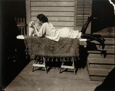 Victorian/Edwardian prostitute relaxes with her puppy in the Storyville red light district, New Orleans. photograph by E.J. Bellocq, sometime before 1915