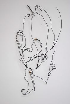 wire self-portrait based off contour drawing: continuous line
