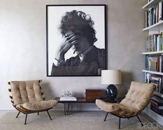 A pair of '60s Brazilian chairs and that photograph of Bob Dylan by Jerry Schatzberg in the living area.