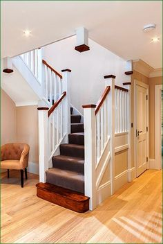 A white primed softwood staircase, featuring two quarter landing turns. The oak bullnose step, handrails and newel caps create a stylish contrast against the other primed elements of the staircase. Painted Staircases, Painted Stairs, Wooden Stairs, White Staircase, Curved Staircase, Staircase Design, Hallway Designs, Hallway Ideas, House