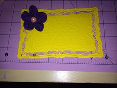 Yellow card with fabric flower