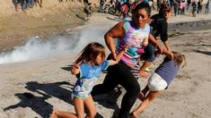 A migrant family runs from tear gas released by US border patrol agents near the fence between Tijuana, Mexico, and San Diego. Immigration Debate, Mother Photos, Shapes For Kids, Us Border, Iconic Photos, Two Daughters, Inevitable, Running Women, Sports