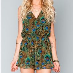RIRI ROMPER The Mumu OG is back! Crossover top, ruffled around the edges, this bohemian dream romper will leave you (and everyone who sees you) speechless. Whether you wear her to a music festival, a day at the resort, to your bridal shower or even just to class the RiRi Romper is a must. *MADE IN THE GORGE USA* *100% Poly Chiffon *Button in back *Elastic Waist *Lined *Basically Wrinkle-proof. Throw in purse for later recommended Show Me Your MuMu Shorts