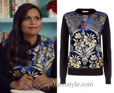 In Mindy's Christmas ad for Tory Burch she wears this gold foiled and navy blue velvet floral print sweater.  Tory Burch Hollis Sweater - $348 (also here and here)
