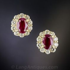 A pair of rich opaque red rubies weighing one carat each, fill sparkling halos of bright-white and sparkling round brilliant-cut diamonds set in gleaming 18K yellow gold. Beautifully and beautifully priced classic estate earrings.1/2 by 3/8 inch.