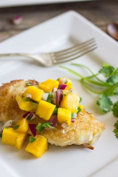 Chicken coated in a crispy coconut breading topped with a sweet and mildly spicy mango salsa.