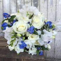 bouquet of forget me not, avalanche roses, freesia and sweet peas by blue sky flowers