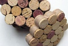 Cork coasters, hot glued and wrapped in ribbon of choice | 10 #DIY Wine Cork Projects @Kacie Jenkins Jenkins Weaver Simmons - we should make these! we've got to start doing some SERIOUS wine drinking to stock up for our craftiness