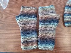 """These crocheted mitts are accentuated by the beautiful slow-stripes of Mochi Plus. The colors change by themselves. Working in the back of the stitch pushes the line of V's forward, creating horizontal """"coils"""" that are reminiscent of vertiacal knitted ribbing."""