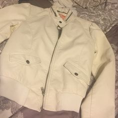 Cream Moto jacket This jacket is cream in color with zipper detail has been worn one time Jackets & Coats