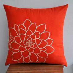 Orange pillow.