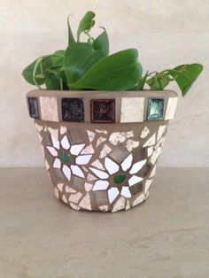 A personal favorite from my Etsy shop https://www.etsy.com/listing/233420061/handmade-mosaic-flower-pot-outdoor