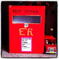 Postman Pat post box made from a cardboard box! Brilliant for imaginative play with your children.