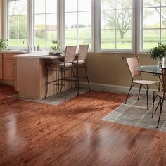 """Open floor plans make for a light and airy feeling, but where do you put the dining room table?  Use flooring to designate living spaces.  Mix materials and colors for a personal touch -- create a tile """"rug"""" in the dining area or use lighter and darker shades of wood to distinguish activity areas."""