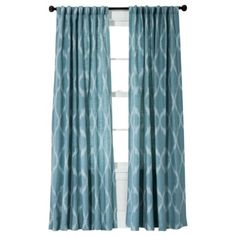 Jacquard Ikat Window Panel in teal just turned my living room into a whole new space