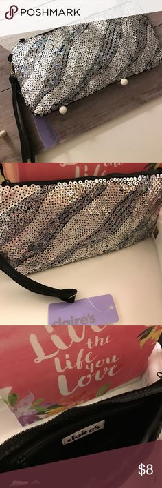 Silver glitter sequined wristlet Brand new with tag; detachable strap to clutch; zippered pocket inside Claire's Bags Clutches & Wristlets