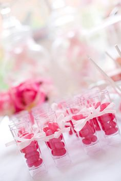 Display candy in mini dessert glasses.  Perfect for one individual serving.