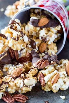 Caramel Moose Munch Fancy Popcorn is crunchy, sweet, and chocolatey, caramel corn sprinkled with three kinds of nuts, and drizzled in two types of chocolate Popcorn Mix, Gourmet Popcorn, Popcorn Snacks, Flavored Popcorn, Moose Munch Popcorn Recipe, Popcorn Balls, Moose Crunch Recipe, Homemade Popcorn, Snack Mix Recipes