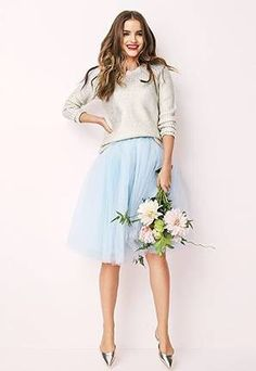 You can absolutely wear a ridiculously formal wedding dress to city hall. You do you.  But if you would prefer not to, there are tons of stylish options for your big day.  You could certainly Carrie Bradshaw it in a vintage suit (much love, SJP), or go for the unbeatable casual and girly combo of a pullover sweater and tulle skirt like this bride.