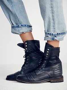 Sounder Lace Up Boot   Distressed leather combat boots with exposed stitching and luxe stretch detailing at the back ankle . Partial grommet lace-up with hooks at topline.