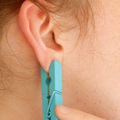 She Puts A Clothespin On Her Ear For One BRILLIANT Reason. I'm Totally Trying This!