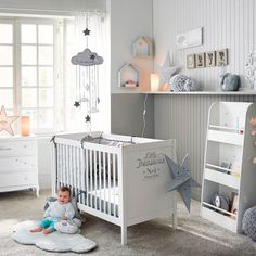 Pure white nursery with baby blue accent