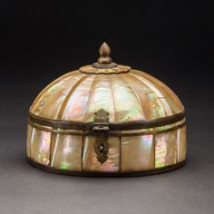 Gujarat mother of pearl container or pandan, India 16th-17th century. Dome shaped box and cover made entirely from mother of pearl with brass...