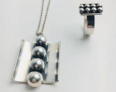 Modernist Elis Kauppi Big Sterling silver pendant and matched silver ring, Kupittaan Kulta Oy, 1964, Made in Finland