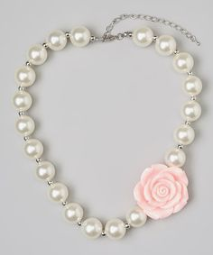 Take a look at this Ivory Pearl Flower Necklace by Olivia Rae. I could totally make these for the girls!!!