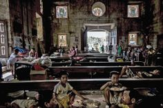 SAMAR ISLAND, PHILIPPINES 11/18/2013 After Typhoon Haiyan, people found refuge at Saint Michael the Archangel Church in Basey.