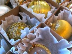 Christmas ornament storage idea: Line individual compartments with a few coffee filters to create a cushion for breakable ornaments that need a little extra protection.