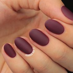 Matte maroon on a perfectly circle nail. The color is strong but the nail shape makes it look softer.