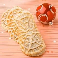 An thin traditional anise flavored Italian cookie made with a pizzelle iron.
