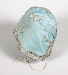 An 18th century blue silk lady's cap