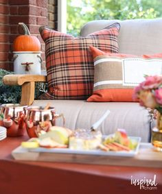 Give your porch a makeover for Fall! Style with pillows in seasonal colors. Shop HomeGoods for beautiful autumnal style like these orange and brown plaid pillows. *sponsored pin*