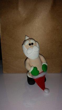 polymer clay naked santa magnet cried
