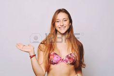 teen girl bikini: Retrato de una mujer joven que presenta algo en traje de baño.