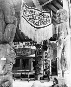 Tlingit totem poles, canoes and a Chilkat blanket on display at Sheldon Jackson Museum, Sitka, Alaska, n.d. :: American Indians of the Pacific Northwest -- Image Portion