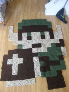 Link crochet rug (54 tan squares, 38 green squares, and 70 brown squares, which is about 162 squares total) by randomheartsx