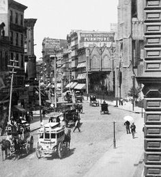 New York City c.1880s. Herter Brothers advertisement on side of building. Leading furniture makers during NYC's Gilded Age for societies elite. {cwl} ~ via AP photo