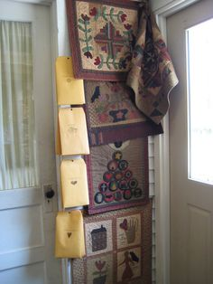 prim quilts by Cheri Payne.....quilts hanging at Country Loft