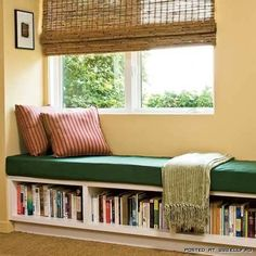 bookshelves under bench seat. This would be great in the loft.