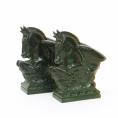 A pair of Harcourts verdi gris patinated bronze bookends the design attributed to Donald Gilbert, each modelled as a hippocampus, stamped Harcourts Made in England 14cm. high