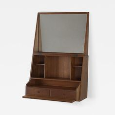 P. Jensen wall-mounted vanity   Denmark, c. 1960   teak, mirror   21.5 w x 10 d x 35.5 h inches   Vanity features a flip-top concealing mirror, shelving, two drawers and one pull-out surface; vanity measures seventeen inches when closed. Signed with applied foil manufacturer's label to cleat: [Kobenhavn Sct. Hansgade 9 Danmark P. Jensen].