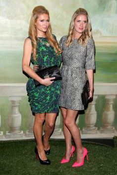 Paris Hilton and Nicky Hilton attend the alice + olivia by Stacey Bendet Spring 2015 NYFW Presentation