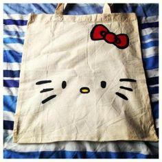 ezebee - Hand-Painted Hello Kitty Canvas Tote Bag http://www.ezebee.com/allthesmallthings182