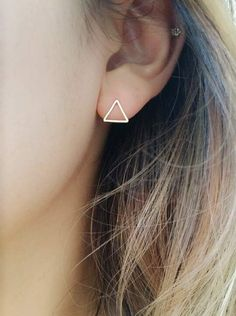 ♣ Free shipping on additional items   This listing is for a PAIR of our gorgeous Triangle Earrings, measuring 9mm x 9mm x 9mm. Each earring comes with a butterfly earring stopper. For any occasions be it a casual hang out with friends, a stroll around the park or a romantic night out, these earrings will perfectly complement your look ♥  Triangle Size: 9mm x 9mm x 9mm Available in gold and silver   OTHER GORGEOUS GEOMETRIC EARRINGS: Circle Earring Studs: https://www.etsy.com/li...