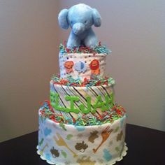 Diaper cake wrapped in blankets.