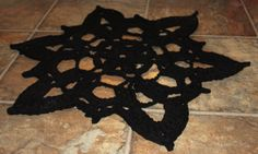 Crochet rug from a sheet. Make your own t-shirt yarn.