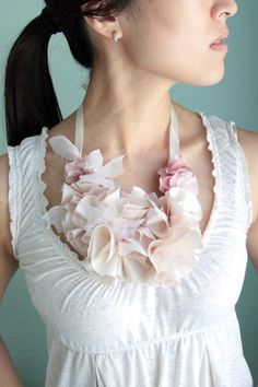 Such a simple way to learn how to make a fabric flower. Just use up your fabric scraps!